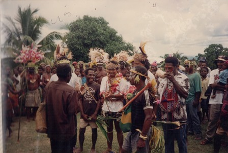 People who live in the jungle of Papua New Guinea gather together after the Catholic Mass is celebrated.