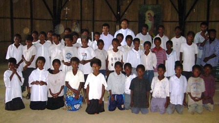 "Children in the jungle ""bush"" of Papua New Guinea rejoice together after receiving their First Holy Communion."