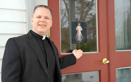 Marian Father Chris Alar encourages everyone to