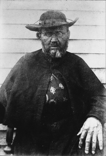 Saint Damien of Molokai, taken in 1889, weeks before his death, by photographer William Brigham, at a side wall on the Hawaiian colony for lepers at Saint Philomena Catholic Church.