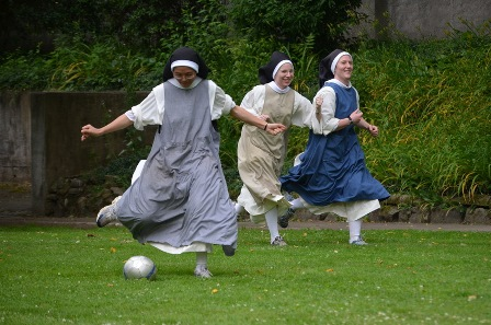 Young Dominican nuns in full habit, from the Monastery of Our Lady of the Rosary in Summit, New Jersey, enjoy a game of soccer.